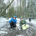 My siblings in the snow in the woods